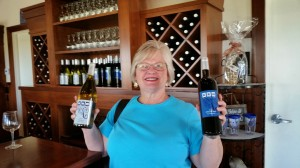 Charlene celebrates by picking two wines after our first tasting today. A red for Ed and a muscato for Charlene.