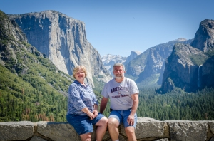 Charlene and Ed at Tunnel View with El Capitan, Half Dome, and Bridalveil Fall behind them.