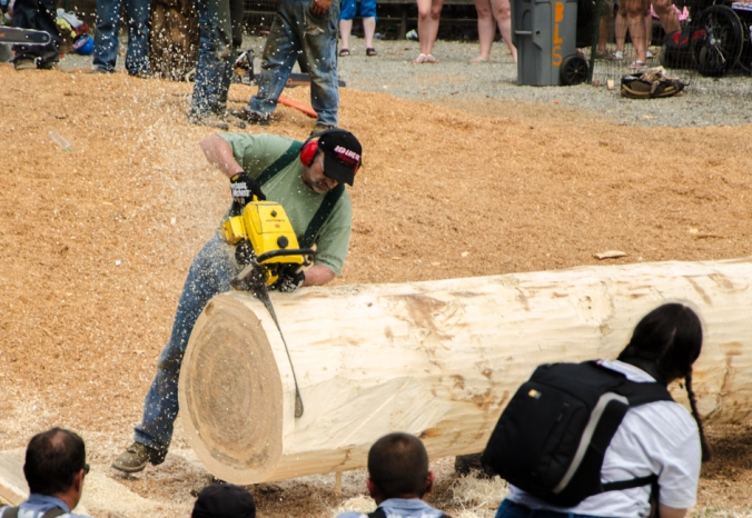 Who can use their chain saw to saw through this log the fastest?