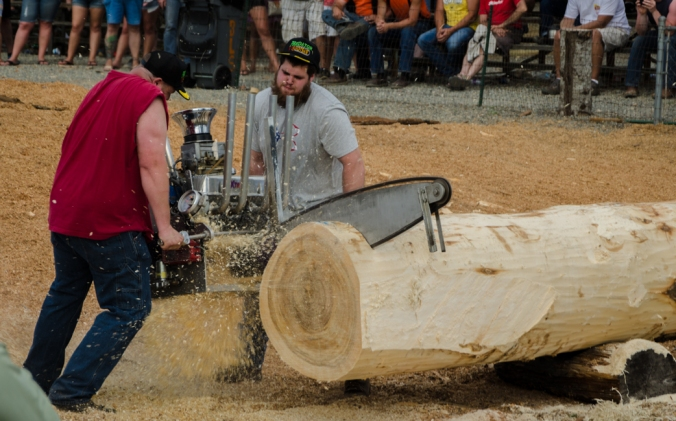 These guy's car engine-powered chain saw won the competition!