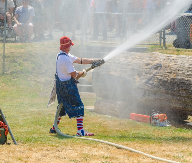 Because it was hot, everyone loved it when the clown provided air conditioning by spraying them with water.