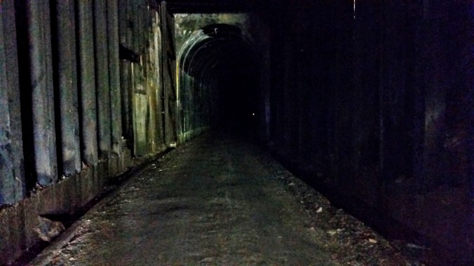 Inside the St. Paul Pass Tunnel that is 1.7 miles long, completely dark inside, and quite chilly in temperature.