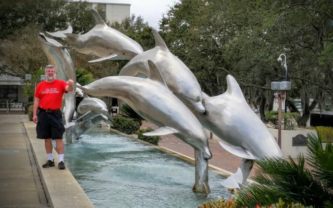 Ed with dolphin statue